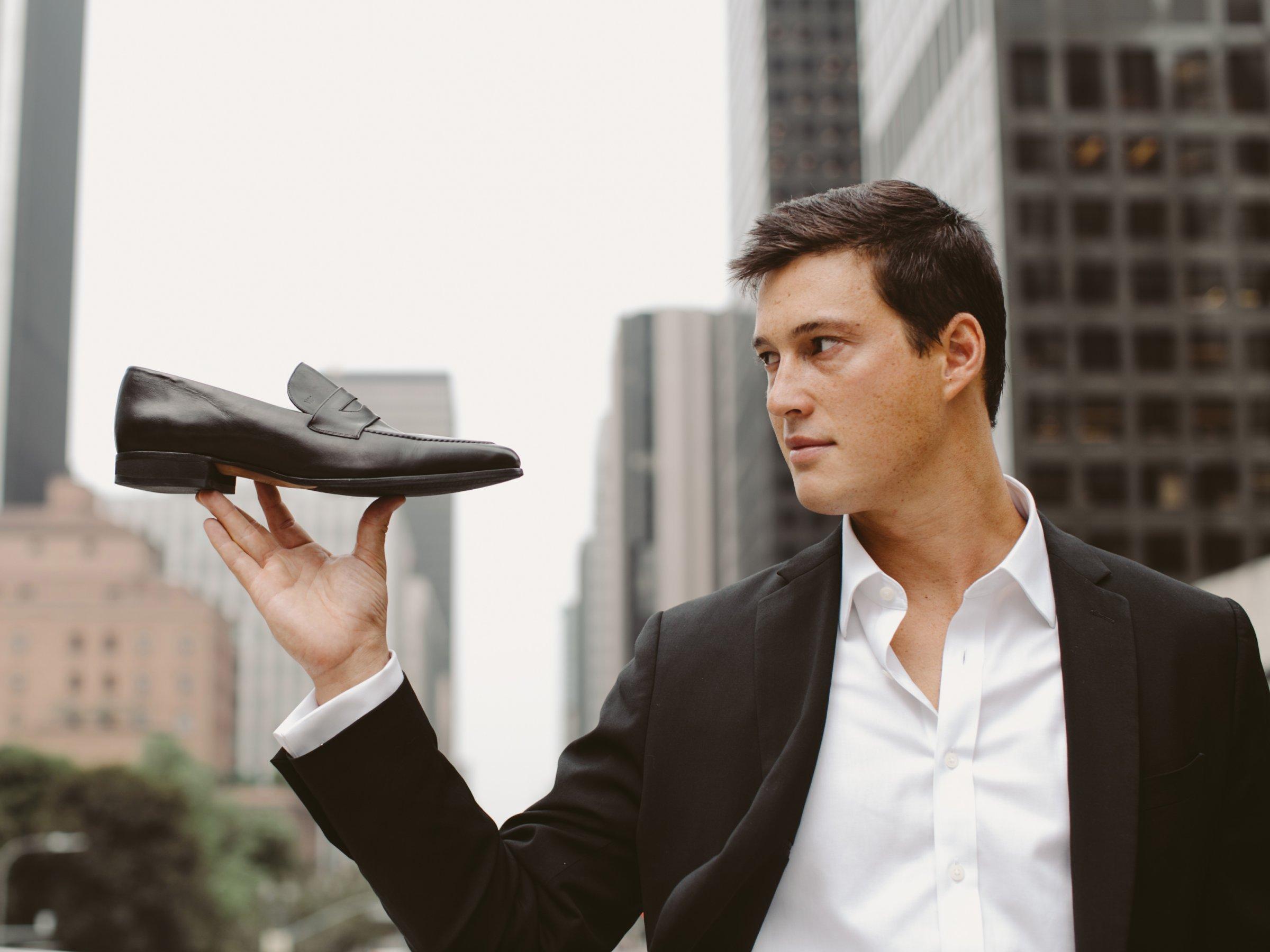 founder_holding shoe 2