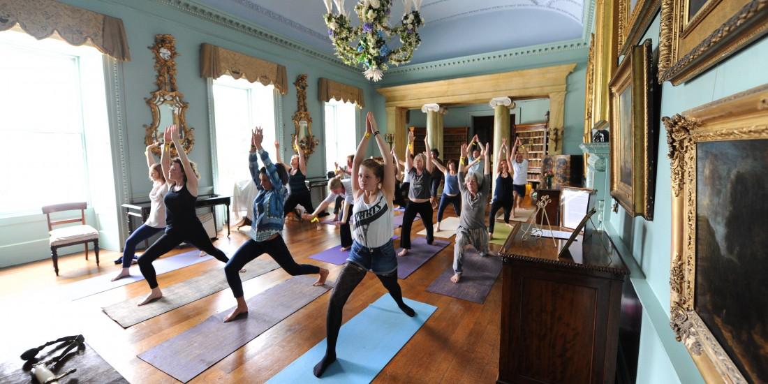 PE126-Ashtanga-Yoga-classes-in-the-Drawing-Room-at-Port-Eliot-2012.-Credit-Michael-Bowles-1-1100x550